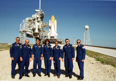 KENNEDY SPACE CENTER, Fla. -- On the launch pad, the STS-108 crew and Expedition 4 crew pause for a photo during Terminal Countdown Demonstration Test activities, which include emergency exit from the launch pad and a simulated launch countdown. From left are STS-108 Commander Dominic L. Gorie, Pilot Mark E. Kelly, and Mission Specialists Daniel M. Tani and Linda A. Godwin; and Expedition 4 crew Daniel W. Bursch, Commander Yuri Onufrienko and Carl E. Walz. STS-108 is a Utilization Flight that will carry the replacement Expedition 4 crew to the International Space Station, as well as the Multi-Purpose Logistics Module Raffaello, filled with supplies and equipment. The l1-day mission is scheduled for launch Nov. 29 on Space Shuttle Endeavour