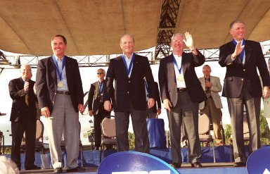 """KENNEDY SPACE CENTER, Fla. -- Astronaut Hall of Fame inductees Robert Crippen, Frederick """"Rick"""" Hauck, Richard Truly and Joe Engle acknowledge the applause from the audience. The four were honored as the first Shuttle astronauts in a ceremony at the KSC Visitor Complex Nov. 10."""