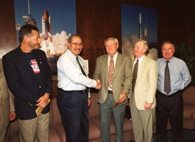 KENNEDY SPACE CENTER, Fla. -- ISS International Partners donate funds to the Combined Federal Campaign and United Way at KSC to benefit the Sept. 11 recovery efforts. From left are Steve Mozes of the Canadian Space Agency, Agostino Verghini of the Italian Space Agency, Frank Ramsey of United way, Center Director Roy D. Bridges Jr. and Director of International Space Station/Payload Processing Tip Talone