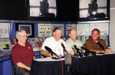"""KENNEDY SPACE CENTER, Fla. -- The first four Shuttle astronauts -- seated, from left, Richard Truly, Joe Engle, Frederick """"Rick"""" Hauck and Robert Crippen -- share a light moment about their experiences while seated in a replica of the early launch control center in the KSC Visitor Complex. All were inducted into the U.S. Astronaut Hall of Fame Nov. 10"""