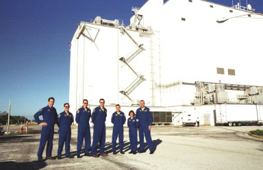 KENNEDY SPACE CENTER, Fla. -- The STS-109 crew poses for a group photo outside the Vertical Processing Facility at KSC. From left are Mission Specialist James Newman, Payload Commander John Grunsfeld, Mission Specialist Richard Linnehan, Commander Scott Altman, Pilot Duane Carey, and Mission Specialists Nancie Currie and Michael Massimino. STS-109 is the Hubble Space Telescope (HST) Servicing mission. The crew comprises Commander Scott Altman, Pilot Duane Carey, Payload Commander John Grunsfeld and Mission Specialists Nancy Currie, James Newman, Richard Linnehan and Michael Massimino. The goal of the mission is to service the HST, replacing Solar Array 2 with Solar Array 3, replacing the Power Control Unit, removing the Faint Object Camera and installing the Advanced Camera for Surveys, installing the Near Infrared Camera and Multi-Object Spectrometer (NICMOS) Cooling System, and installing New Outer Blanket Layer insulation on bays 5 through 8. Mission STS-109 is scheduled for launch Feb. 14, 2002