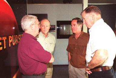 """KENNEDY SPACE CENTER, Fla. -- The first four Shuttle astronauts share a moment of nostalgia at the Kennedy Space Center Visitor Complex. Pictured from left are Richard Truly, Frederick """"Rick"""" Hauck, Robert Crippen and Joe Engle. All were inducted into the U.S. Astronaut Hall of Fame Nov. 10."""