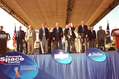 """KENNEDY SPACE CENTER, Fla. -- The outdoor stage at the KSC Visitor Complex is filled with members of the Astronaut Hall of Fame who gathered to honor the four standing in the front center: Robert Crippen (second from left), Frederick """"Rick"""" Hauck, Richard Truly and Joe Engle. These first Shuttle astronauts were the 2001 inductees."""
