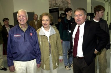 KENNEDY SPACE CENTER, FLA. -- Former President Jimmy Carter (left) and Rosalyn Carter visit the Space Station Processing Facility on their tour of Kennedy Space Center. With them (right) is Director of Payload Processing, International Space Station, Tip Talone (left of Rosalyn Carter)