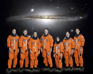 JOHNSON SPACE CENTER, HOUSTON, TEXAS -- (JSC STS109-5-002) -- STS-109 CREW PORTRAIT -- Seven astronauts take a break from training for the STS-109 mission to pose for the traditional pre-flight crew portrait. From the left are astronauts Michael J. Massimino, Richard M. Linnehan, Duane G. Carey, Scott D. Altman, Nancy J. Currie, John M. Grunsfeld and James H. Newman. Altman and Carey are commander and pilot, respectively, with the others serving as mission specialists. Grunsfeld is payload commander. The group will be the fourth to visit the Hubble Space Telescope (HST) for performing upgrade and servicing on the giant orbital observatory