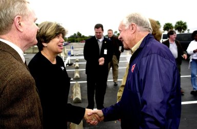KENNEDY SPACE CENTER, FLA. -- Director of External Affairs and Business Development JoAnn H. Morgan greets former President Jimmy Carter on his visit to Kennedy Space Center. At far left is Center Director Roy D. Bridges Jr. Carter and former First Lady Rosalyn Carter are touring KSC