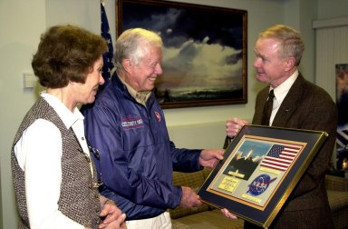 KENNEDY SPACE CENTER, FLA. -- During a visit to Kennedy Space Center, former President Jimmy Carter (center) receives a special presentation from Center Director Roy D. Bridges Jr. With Carter is his wife, former first lady Rosalyn Carter