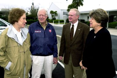 KENNEDY SPACE CENTER, FLA. - Rosalyn and Jimmy Carter, former first lady and U.S. President , talk with Center Director Roy D. Bridges Jr. and Director of External Affairs and Business Development JoAnn H. Morgan. The Carters are touring Kennedy Space Center
