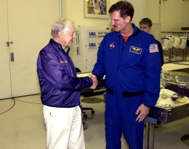 KENNEDY SPACE CENTER, FLA. -- Former President Jimmy Carter shakes the hand of astronaut Joseph Tanner. Carter and former First Lady Rosalyn Carter are touring KSC