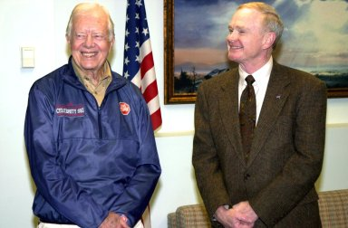 KENNEDY SPACE CENTER, FLA. -- During a visit to Kennedy Space Center, former President Jimmy Carter (left) pauses for a photo with Center Director Roy D. Bridges