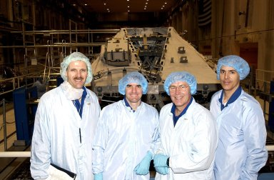 KENNEDY SPACE CENTER, FLA. -- In the Operations and Checkout Building, members of the STS-110 crew take a break from checking equipment to pose for a photo: (from left) Mission Specialists Steven Smith, Rex Walheim, Jerry Ross and Lee Morin. Other crew members (not shown) are Commander Michael J. Bloomfield, Pilot Stephen N. Frick, and Mission Specialist Ellen Ochoa. Part of the payload on the mission is the Integrated Truss Structure S0. It is the center segment that they will be installing on the International Space Station, part of the 300-foot (91-meter) truss attached to the U.S. Lab. By assembly completion, four more truss segments will attach to either side of the S0 truss. STS-110 is currently scheduled to launch in April 2002