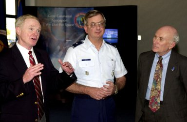 KENNEDY SPACE CENTER, FLA. - After a ribbon cutting at the formal opening of a Customer Service office at the Cape Canaveral Spaceport, Center Director Roy Bridges (left) offers a few comments. With him are Brig. Gen. Donald P. Pettit (center)l, commander of the 45th Space Wing, and Executive Director of the Cape Canaveral Spaceport Management Office Ed Gormel (right)