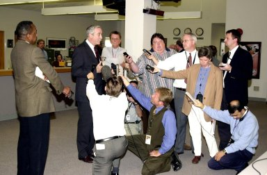KENNEDY SPACE CENTER, Fla. - The new NASA Administrator Sean O'Keefe (second from left) is interviewed by the press in the KSC Newsroom. The administrator was at KSC on an agencywide familiarization tour of NASA field centers. He was nominated for the position as administrator in November 2001 by President George W. Bush. He was sworn in Dec. 21 as the agency's tenth chief