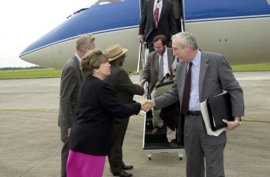 KENNEDY SPACE CENTER, Fla. -- The new NASA Administrator Sean O'Keefe (right) is greeted by KSC's Director of External Relations and Business Development JoAnn H. Morgan (left) after his arrival at KSC. Next to Morgan is Deputy Director James Jennings, also greeting others exiting the plane. O'Keefe is touring agency field centers. O'Keefe was nominated for the position as administrator in November 2001 by President George W. Bush. He was sworn in Dec. 21 as the agency's 10th chief