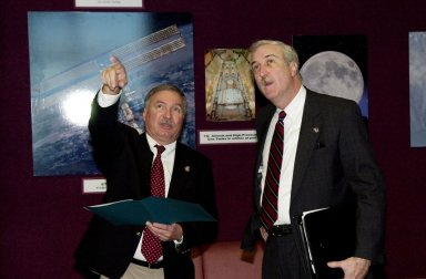 KENNEDY SPACE CENTER, Fla. - Director of International Space Station/Payload Processing Tip Talone (left) informs the new NASA Administrator Sean O'Keefe (at right) about the elements of the Space Station in the Space Station Processing Facility. The administrator was at KSC on an agencywide familiarization tour of NASA field centers. He was nominated for the position as administrator in November 2001 by President George W. Bush. He was sworn in Dec. 21 as the agency's 10th chief