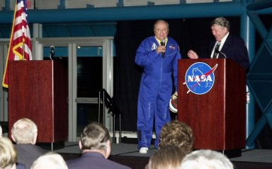 """KENNEDY SPACE CENTER, FLA. - In his comedic persona of """"astronaut Jose Jimenez"""" popular during the early days of the space program, comedian Bill Dana (left) regales space pioneer Wally Schirra (right) and the audience with his famous routine. The occasion was the celebration of the 40th anniversary of American spaceflight. The dinner event was held at KSC's Apollo/Saturn V Center."""