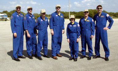 KENNEDY SPACE CENTER, FLA. - The STS-109 crew poses at the Cape Canaveral Air Force Station Skid Strip before departing for Houston. The crew returned to KSC aboard Columbia March 12 after an 11-day mission servicing the Hubble Space Telescope. From left to right are Mission Specialists Michael Massimino and Richard Linnehan; Pilot Duane Carey; Commander Scott Altman; and Mission Specialists Nancy Currie, John Grunsfeld and James Newman. Grunsfeld was Payload Commander on the mission