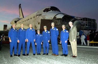 KENNEDY SPACE CENTER, FLA. -- Posing in front of orbiter Columbia is the returning STS-109 crew along with NASA Administrator Sean O'Keefe (right). From left are Mission Specialists Richard Linnehan, James Newman, Michael Massimino and Nancy Jane Currie; Pilot Duane Carey; Commander Scott Altman; Payload Commander John Grunsfeld; and O'Keefe. The crew returned to Earth after a successful 11-day mission servicing the Hubble Space Telescope. Wheel stop occurred on orbit 165 at 4:33:09 a.m. EST. Main gear touchdown occurred at 4:31:52 a.m. and nose wheel touchdown at 4:32:02. Rollout time was 1 minute, 17 seconds. This was the 58th landing at KSC out of 108 missions in the history of the Shuttle program