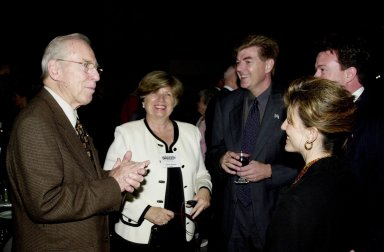 KENNEDY SPACE CENTER, FLA. - The 40th anniversary celebration of American spaceflight was capped with a dinner held at the KSC Apollo/Saturn V Center. Former astronaut Jim Lovell (left), who hosted the event, talks with JoAnn H. Morgan (next to Lovell) and other guests. Morgan is director of External Affairs and Business Development at KSC.