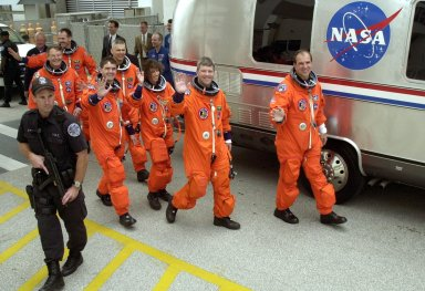 """KENNEDY SPACE CENTER, FLA. -- The STS-110 crew heads for the Astrovan and a ride to Launch Pad 39B for the launch scheduled at 4:40 p.m. EDT (20:40 GMT). From left-foreground are Mission Specialists Jerry L. Ross and Rex J. Walheim; left, second row, are Mission Specialists Steven L. Smith, Lee M.E. Morin, Ellen Ochoa; Pilot Stephen N. Frick; and Commander Michael J. Bloomfield. STS-110 is the 13th assembly flight to the International Space Station, carrying the S0 Integrated Truss Structure and Mobile Transporter (MT). On the 11-day mission, the mission features four spacewalks to attach the S0 truss, which will become the backbone of the Space Station, to the U.S. Lab, """"Destiny."""" The MT, a space """"railcar,"""" is attached to the truss segment and will make its debut run during the flight"""