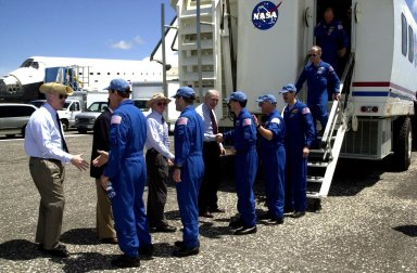 KENNEDY SPACE CENTER, FLA. -- The STS-110 crew exit from the Crew Hatch Access Vehicle and are greeted by NASA Administrator Sean O'Keefe, Center Director Roy Bridges Jr. and mission managers. The crew members are, left to right, Commander Michael Bloomfield, Pilot Stephen Frick, and Mission Specialists Rex Walheim, Jerry Ross and Steven Smith. Missing from the photo are Mission Specialists Ellen Ochoa and Lee Morin. Atlantis landed on KSC's Shuttle Landing Facility after 171 orbits, completing a 10-day, 19-hour, 4.5-million mile mission to the International Space Station. Main gear touchdown was 12:26:57 p.m. EDT, nose gear touchdown was 12:27:09 p.m. and wheel stop was 12:28:07 p.m. The crew delivered and installed the S0 truss, which will support cooling and power systems essential for the addition of future international laboratories, on the Station