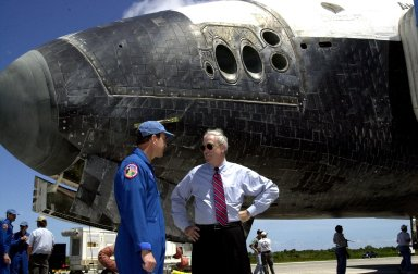 KENNEDY SPACE CENTER, FLA. -- Standing next to the nose of Atlantis, returned from its successful mission STS-110 to the International Space Station, Commander Michael Bloomfield talks with NASA Administrator Sean O'Keefe. Atlantis landed on KSC's Shuttle Landing Facility after 171 orbits, completing a 10-day, 19-hour, 4.5-million mile journey. Main gear touchdown was 12:26:57 p.m. EDT, nose gear touchdown was 12:27:09 p.m. and wheel stop was 12:28:07 p.m. The crew delivered and installed the S0 truss, which will support cooling and power systems essential for the addition of future international laboratories, on the Station