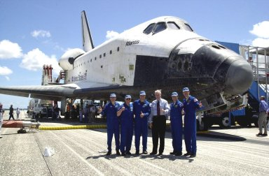 KENNEDY SPACE CENTER, FLA. -- Members of the STS-110 crew pose with NASA Administrator Sean O'Keefe in front of orbiter Atlantis after their return from the International Space Station. Standing left to right are Mission Specialists Rex Walheim and Jerry Ross, Commander Michael Bloomfield, O'Keefe, Pilot Stephen Frick and Mission Specialist Steven Smith. Missing crew members are Mission Specialists Ellen Ochoa and Lee Morin. Atlantis landed on KSC's Shuttle Landing Facility after 171 orbits, completing a 10-day, 19-hour, 4.5-million mile mission. Main gear touchdown was 12:26:57 p.m. EDT, nose gear touchdown was 12:27:09 p.m. and wheel stop was 12:28:07 p.m. The crew delivered and installed the S0 truss, which will support cooling and power systems essential for the addition of future international laboratories, on the Station