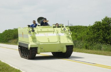 KENNEDY SPACE CENTER, FLA. -- During Terminal Countdown Demonstration Test activities at KSC, Expedition 5 member Peggy Whitson drives the M-113 armored personnel carrier, used for emergency egress training at the pad. Passengers in the vehicle are Expedition 5 Commander Valeri Korzun and George Hoggard (center), with the KSC/CCAS Fire Department, who supervises the driving. Expedition 5 will travel to the International Space Station on mission STS-111 as the replacement crew for Expedition 4, who will return to Earth aboard Endeavour. The TCDT also includes a simulated launch countdown Known as Utilization Flight -2, the mission includes attaching a Canadian-built mobile base system to the International Space Station that will enable the Canadarm2 robotic arm to move along a railway on the Station's truss to build and maintain the outpost. The crew will also replace a faulty wrist/roll joint on the Canadarm2 as well as unload almost three tons of experiments and supplies from the Italian-built Multi-Purpose Logistics Module Leonardo. Launch of Space Shuttle Endeavour on mission STS-111 is scheduled for May 30, 2002