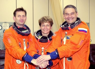 KENNEDY SPACE CENTER, FLA. -- The Expedition 5 crew poses during suitup prior to going to the launch pad for a simulated countdown. From left are astronaut Sergei Treschev, astronaut Peggy Whitson and Commander Valeri Korzun. Treschev and Korzun are with the Russian Space Agency. The simulation is part of STS-111 Terminal Countdown Demonstration Test activities, which also includes the mission crew Commander Kenneth Cockrell, Pilot Paul Lockhart and Mission Specialists Franklin Chang-Diaz and Philippe Perrin, with the French Space Agency. The payload on the mission to the International Space Station includes the Mobile Base System, an Orbital Replacement Unit and Multi-Purpose Logistics Module Leonardo. The Expedition 5 crew is traveling on Endeavour to replace the Expedition 4 crew on the Station. Launch of Endeavour is scheduled for May 30, 2002.