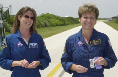 KENNEDY SPACE CENTER, FLA. -- Astronaut Tracy Caldwell (left), a mission specialist candidate currently assigned to the Astronaut Office Space Station Operations Branch, joins Expedition 5 crew member Peggy Whitson (right) during a break in Terminal Countdown Demonstration Test activities at KSC. The TCDT includes emergency egress training at the pad and a simulated launch countdown. Expedition 5 will travel to the International Space Station on mission STS-111 as the replacement crew for Expedition 4, who will return to Earth aboard Endeavour. Known as Utilization Flight -2, the mission includes attaching a Canadian-built mobile base system to the International Space Station that will enable the Canadarm2 robotic arm to move along a railway on the Station's truss to build and maintain the outpost. The crew will also replace a faulty wrist/roll joint on the Canadarm2 as well as unload almost three tons of experiments and supplies from the Italian-built Multi-Purpose Logistics Module Leonardo. Launch of Space Shuttle Endeavour on mission STS-111 is scheduled for May 30, 2002