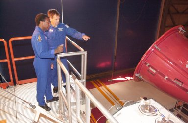 KENNEDY SPACE CENTER, FLA. -- In the Orbiter Processing Facility, STS-107 Payload Commander Michael Anderson (left) and 107 Payload Specialist Ilan Ramon, with the Israeli Space Agency, look at one of the main engines on Columbia. A research mission, STS-107 will carry as the primary payload the first flight of the SHI Research Double Module (SHI/RDM), also known as SPACEHAB. The experiments range from material sciences to life sciences. Another payload is FREESTAR (Fast Reaction Experiments Enabling Science, Technology, Applications and Research) comprising Mediterranean Israeli Dust, Solar Constant, Shuttle Ozone Limb Sounding, Critical Viscosity of Xenon, Low Power, and Space Experimental Module experiments. STS-107 is scheduled to launch July 11, 2002