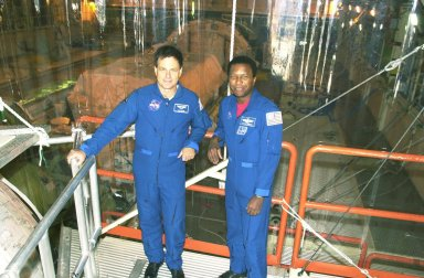 KENNEDY SPACE CENTER, FLA. - STS-107 Payload Specialist Ilan Ramon (left), with the Israeli Space Agency, and Payload Commander Michael Anderson pause during a payload check in the Orbiter Processing Facility. A research mission, STS-107 will carry as the primary payload the first flight of the SHI Research Double Module (SHI/RDM), also known as SPACEHAB. The experiments range from material sciences to life sciences. Another payload is FREESTAR (Fast Reaction Experiments Enabling Science, Technology, Applications and Research) comprising Mediterranean Israeli Dust, Solar Constant, Shuttle Ozone Limb Sounding, Critical Viscosity of Xenon, Low Power, and Space Experimental Module experiments. STS-107 is scheduled to launch July 11, 2002