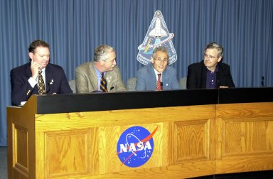 KENNEDY SPACE CENTER, FLA. -- In the Press Site auditorium, space agency officials participate in a media briefing following the launch scrub of Space Shuttle mission STS-111. From left are NASA/JSC Public Affairs Officer Kyle Herring, NASA Administrator Sean O'Keefe, French Space Agency President Dr. Alain Bensoussan, and Canadian Space Agency President Dr. Marc Garneau. STS-111 is the second Utilization Flight to the International Space Station, carrying the Multi-Purpose Logistics Module Leonardo, the Mobile Base System (MBS), and a replacement wrist/roll joint for the Canadarm 2. Also on board will be the Expedition Five crew who will replace Expedition Four on the Station. Launch is rescheduled for May 31 at 7:22 p.m. EDT