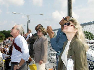 KENNEDY SPACE CENTER, FLA. -- NASA Administrator Sean O'Keefe (left), External Relations and Business Development Director JoAnn Morgan (center) and other guests watch the launch of Space Shuttle Endeavour on mission STS-111 to the International Space Station. Liftoff occurred on time at 5:22:49 p.m EDT. This mission marks the 14th Shuttle flight to the International Space Station and the third Shuttle mission this year. Mission STS-111 is the 18th flight of Endeavour and the 110th flight overall in NASA's Space Shuttle program