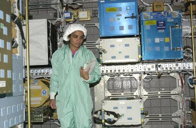 KENNEDY SPACE CENTER, FLA. - STS-107 Mission Specialist Kalpana Chawla looks at equipment inside the SHI Research Double Module (SHI/RDM), part of the payload on the mission. The crew is taking part in Crew Equipment Interface Test activities, which include equipment and payload familiarization. A research mission, STS-107 also will carry the Fast Reaction Experiments Enabling Science, Technology, Applications and Research (FREESTAR) that incorporates eight high priority secondary attached shuttle experiments. STS-107 is scheduled to launch July 19, 2002