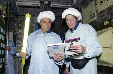 KENNEDY SPACE CENTER, FLA. -- STS-107 Mission Specialists Ilan Ramon, with the Israeli Space Agency, holds a light wand while he and Laurel Clark check out data for equipment in the SHI Research Double Module (SHI/RDM), part of the payload on the mission. They are taking part in Crew Equipment Interface Test activities, which include equipment and payload familiarization. A research mission, STS-107 also will carry the Fast Reaction Experiments Enabling Science, Technology, Applications and Research (FREESTAR) that incorporates eight high priority secondary attached shuttle experiments. STS-107 is scheduled to launch July 19, 2002