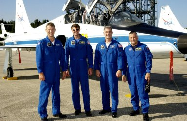 KENNEDY SPACE CENTER, Fla. - The STS-112 crew pauses for a group photo after arriving at the Shuttle Landing Facility. From left are Mission Specialist Piers Sellers, Commander Jeffrey Ashby, and Mission Specialists David Wolf and Fyodor Yurchikhin, who is with the Russian Space Agency. Not shown is Pilot Pamela Melroy. The crew will be taking part in Terminal Countdown Demonstration Test activities in preparation for the mission aboard Space Shuttle Atlantis, which is scheduled to launch no earlier than Oct. 2, between 2 and 6 p.m. EDT. STS-112 is the 15th assembly mission to the International Space Station. Atlantis will be carrying the S1 Integrated Truss Structure, the first starboard truss segment. The S1 will be attached to the central truss segment, S0, during the 11-day mission.