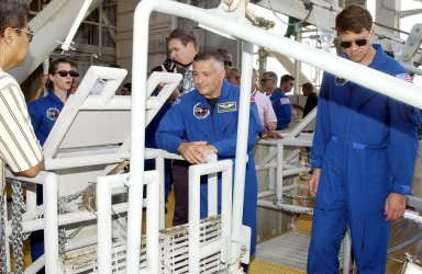 KENNEDY SPACE CENTER, FLA. -- In the foreground, STS-112 Pilot Pamela Melroy (left), Mission Specialist Fyodor Yurchikhin (center) and Commander Jeffrey Ashby (right) watch as a slidewire basket descends to the landing area. The crew is taking part in emergency egress training from the pad, part of Terminal Countdown Demonstration Test activities. Mission STS-112 aboard Space Shuttle Atlantis is scheduled to launch no earlier than Oct. 2, between 2 and 6 p.m. EDT. STS-112 is the 15th assembly mission to the International Space Station. Atlantis will be carrying the S1 Integrated Truss Structure, the first starboard truss segment, to be attached to the central truss segment, S0, and the Crew and Equipment Translation Aid (CETA) Cart A. The CETA is the first of two human-powered carts that will ride along the ISS railway, providing mobile work platforms for future spacewalking astronauts.