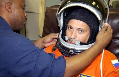 KENNEDY SPACE CENTER, Fla. - STS-112 Mission Specialist Fyodor Yurchikhin has his helmet adjusted during suit check as part of Terminal Countdown Demonstration Test activities. The TCDT also includes emergency egress training and a simulated launch countdown. The mission aboard Space Shuttle Atlantis is scheduled to launch no earlier than Oct. 2, between 2 and 6 p.m. EDT. STS-112 is the 15th assembly mission to the International Space Station. Atlantis will be carrying the S1 Integrated Truss Structure, the first starboard truss segment. The S1 will be attached to the central truss segment, S0, during the 11-day mission. Yurchikhin will assist Pilot Pamela Melroy in preparing the spacewalk hardware for the three scheduled EVAs. STS-112 is Yurchikhin's first Shuttle flight.