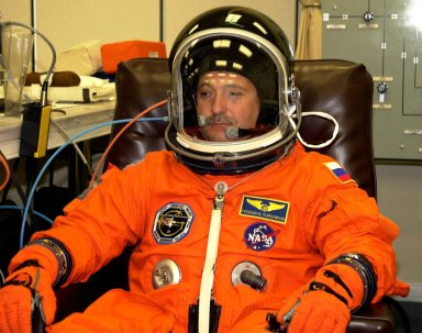 KENNEDY SPACE CENTER, FLA. --STS-112 Mission Specialist Fyodor Yurchikhin, of the Russian Space Agency, dons his spacesuit for a final fit check in preparation for his launch to the International Space Station aboard Atlantis. Launch is scheduled for Oct. 2 between 2 and 6 p.m. EDT.