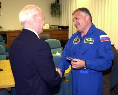 KENNEDY SPACE CENTER, FLA. - Aslan Abashidze, President of the Autonomous Republic of Ajara in Georgia (Russia) shakes hands with STS-112 Mission Specialist Fyodor N. Yurchikhin, Ph.D., (right) a cosmonaut with the Russian Space Agency. Yurchikhin is at Kennedy Space Center awaiting his launch aboard Space Shuttle Atlantis on mission STS-112 to the International Space Station. The launch has been postponed to no earlier than Monday, Oct. 7, so that the Mission Control Center, located at the Lyndon B. Johnson Space Center in Houston, Texas, can be secured and protected from potential storm impacts from Hurricane Lili.