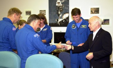 KENNEDY SPACE CENTER, FLA. - In the Operations and Checkout Building, Aslan Abashidze (right), President of the Autonomous Republic of Ajara in Georgia (Russia), visits with the STS-112 crew. From left, they are Mission Specialist Piers J. Sellers; Pilot Pamela Ann Melroy; Mission Specialist Fyodor N. Yurchikhin, a cosmonaut with the Russian Space Agency; Mission Specialist Sandra H. Magnus; and CommanderJeffrey S. Ashby. Mission Specialist David A. Wolf, not pictured, is also a member of the crew. The crew is awaiting launch on mission STS-112 to the International Space Station aboard Space Shuttle Atlantis. The launch has been postponed to no earlier than Monday, Oct. 7, so that the Mission Control Center, located at the Lyndon B. Johnson Space Center in Houston, Texas, can be secured and protected from potential storm impacts from Hurricane Lili.