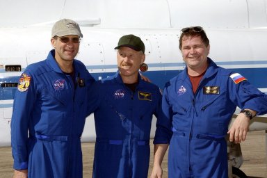 KENNEDY SPACE CENTER, FLA. -- The Expedition 6 crew pauses for the photographer after their arrival at the Shuttle Landing Facility. From left are astronaut Donald Pettit, Commander Ken Bowersox and cosmonaut Nikolai Budarin. The crew is at KSC for Terminal Countdown Demonstration Test activities. Expedition 6 will fly on Space Shuttle Endeavour to the International Space Station on mission STS-113. They will relieve and replace the Expedition 5 crew. Endeavour will also be transporting the Port 1 (P1) truss segment to the Station. STS-113 is scheduled to launch Nov. 10, 2002.