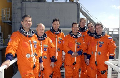 KENNEDY SPACE CENTER, FLA. -- The crews of Mission STS-113 gather for a group photograph on the 195-foot level of the Fixed Service Structure on Launch Pad 39A. From left are STS-113 Pilot Paul Lockhart; Expedition 6 Commander Ken Bowersox; STS-113 Mission Specialists Michael Lopez-Alegria and John Herrington, and Commander James Wetherbee; Expedition 6 astronaut Donald Pettit and cosmonaut Nikolai Budarin. They have been participating in emergency egress training, part of Terminal Countdown Demonstration Test activities in preparation for their launch. The 16th assembly flight to the International Space Station, STS-113 will carry the Port 1 (P1) truss aboard Space Shuttle Endeavour, as well as Expedition 6, who will replace Expedition 5 on the Station. The mission is scheduled to launch Nov. 10, 2002.