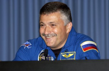 KENNEDY SPACE CENTER, FLA. -- STS-112 Mission Specialist Fyodor Yurchikhin, who represents the Russian Space Agency, smiles at a question posed during the crew's post-landing briefing for the media. Mission STS-112 was the 15th assembly flight to the International Space Station, installing the S1 truss. The landing was the 60th at KSC in the history of the Shuttle program.