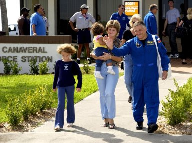 KENNEDY SPACE CENTER, FLA. -- The STS-112 crew departs for Houston after their successful landing Oct. 18 on orbiter Atlantis. Seen with his family is cosmonaut Fyodor Yurchikhin. Mission STS-112 was the 15th assembly flight to the International Space Station, installing the S1 truss. The landing was the 60th at KSC in the history of the Shuttle program.