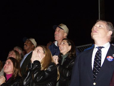KENNEDY SPACE CENTER, FLA. - Among the visitors watching the launch of Space Shuttle Endeavour on mission STS-113 are NASA Administrator Sean O'Keefe (top, center) and Glen Mahone, associate administrator for public affairs, NASA (left of O'Keefe). Liftoff occurred ontime at 7:49:47 p.m. EST. The launch is the 19th for Endeavour, and the 112th flight in the Shuttle program. Mission STS-113 is the 16th assembly flight to the International Space Station, carrying another structure for the Station, the P1 integrated truss. Also onboard are the Expedition 6 crew, who will replace Expedition 5. Endeavour is scheduled to land at KSC after an 11-day journey.