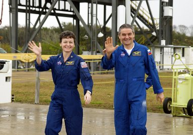 KENNEDY SPACE CENTER, FLA. -- Expedition Five crew members wave to onlookers as they leave KSC for Houston. From left are Science Officer Peggy Whitson and Commander Valery Korzun. Not seen is Flight Engineer Sergei Treschev. The three returned to Earth Dec. 7 on Endeavour, with the STS-113 crew, after six months on the International Space Station.
