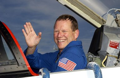 """KENNEDY SPACE CENTER, FLA. -- STS-107 Mission Specialist David Brown arrives at KSC to take part in Terminal Countdown Demonstration Test activities, which include a simulated launch countdown. Other crew members are Commander Rick Husband, Pilot William """"Willie"""" McCool, Payload Commander Michael Anderson, Mission Specialists Kalpana Chawla and Laurel Clark and Payload Specialist Ilan Ramon (the first Israeli astronaut). STS-107 is a mission devoted to research and will include more than 80 experiments that will study Earth and space science, advanced technology development, and astronaut health and safety. Launch is scheduled for Jan. 16, 2003."""