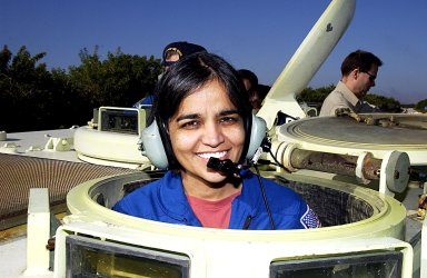 KENNEDY SPACE CENTER, FLA. -- STS-107 Mission Specialist Kalpana Chawla takes a break during training on the operation of an M113 armored personnel carrier during Terminal Countdown Demonstration Test activities, a standard part of launch preparations. STS-107 is a mission devoted to research and will include more than 80 experiments that will study Earth and space science, advanced technology development, and astronaut health and safety. Launch is planned for Jan. 16, 2003, between 10 a.m. and 2 p.m. EST aboard Space Shuttle Columbia.